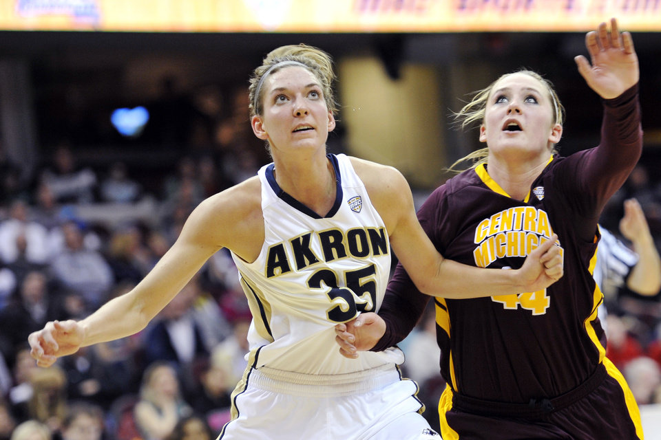 Akron's Carly Young (35) works for a rebound against Central Michigan's Taylor Johnson in the first half in an NCAA college basketball game in the finals of the Mid-American Conference tournament, Saturday, March 16, 2013, in Cleveland. (AP Photo/David Richard) ORG XMIT: OHDR110
