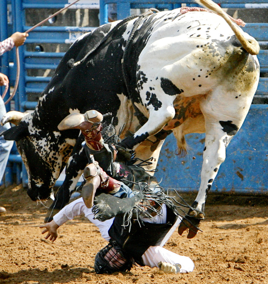 G-Man Norby, of Walsenburg, Co., goes head first into the ground as he is thrown from his bull in the bull riding event during the second day of the International Finals Youth Rodeo Rodeo at the Shawnee Expo Center on Tuesday, July 15, 2008, in Shawnee, Okla.  Staff Photo By CHRIS LANDSBERGER