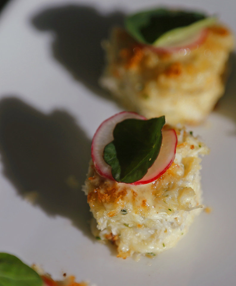 Photo -  Chef Valentine's crab cakes should immediately be considered among the best in the city.