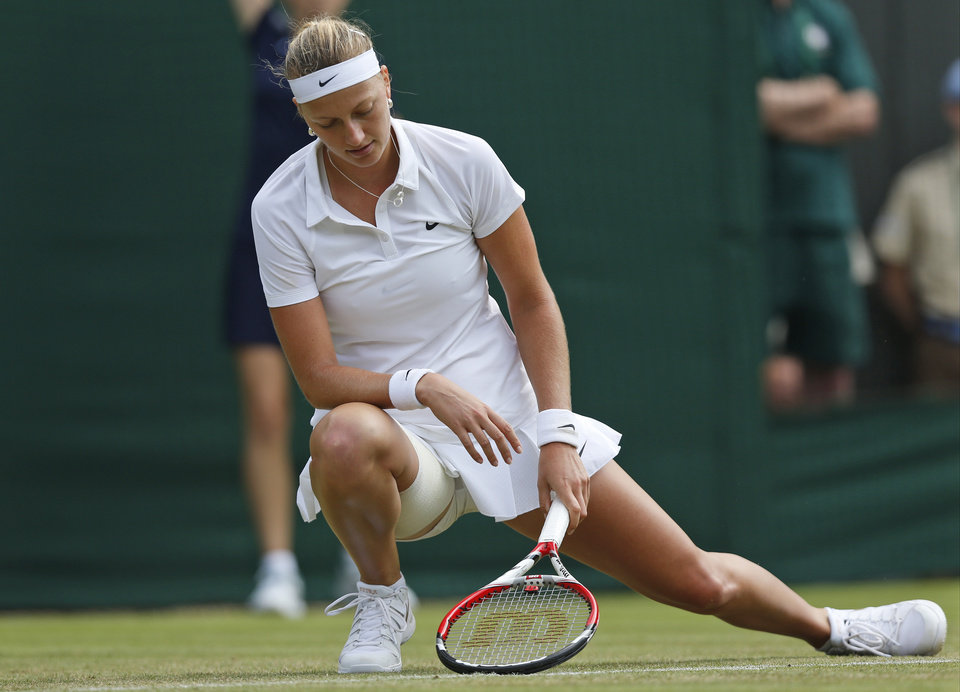 Photo - Petra Kvitova of the Czech Republic looks down after winning a point to Mona Barthel of Germany during their women's singles match at the All England Lawn Tennis Championships in Wimbledon, London, Wednesday, June 25, 2014. (AP Photo/Sang Tan)