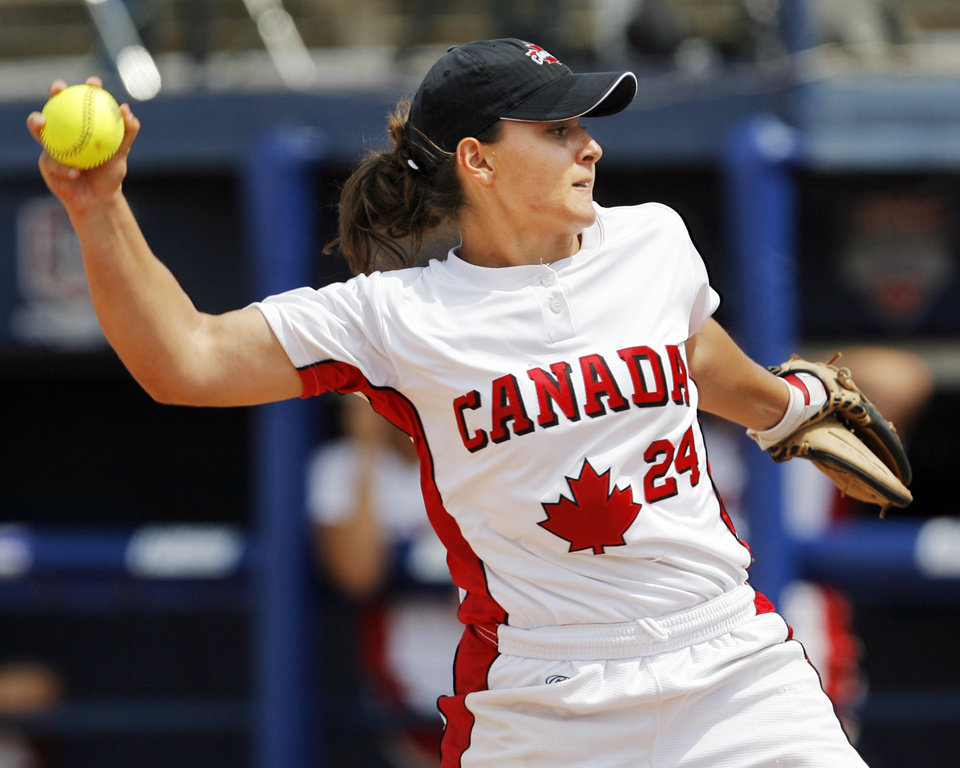 Photo - Jennfier Caira pitches in relief for Canada during the game between Australia and Canada in the World Cup of Softball at ASA Hall of Fame Stadium in Oklahoma City, Friday, July 17, 2009. By Nate Billings, The Oklahoman ORG XMIT: KOD