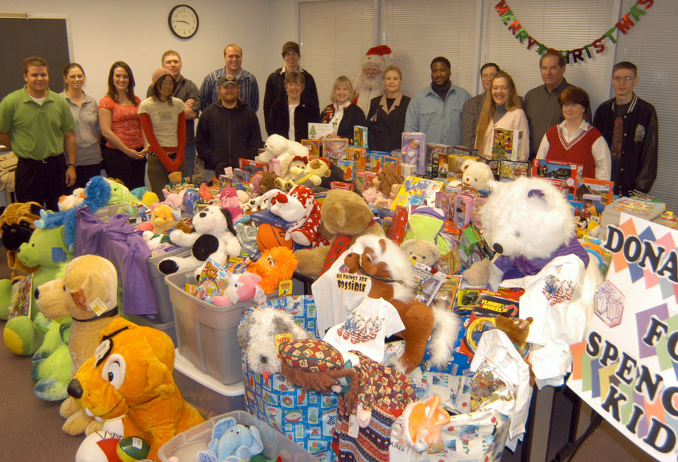 Rose State College Students in Free Enterprise gather around a room full of toys and clothes donated to benefit the children of Integris Mental Health Center.<br/><b>Community Photo By:</b> Steve Reeves<br/><b>Submitted By:</b> natalie,