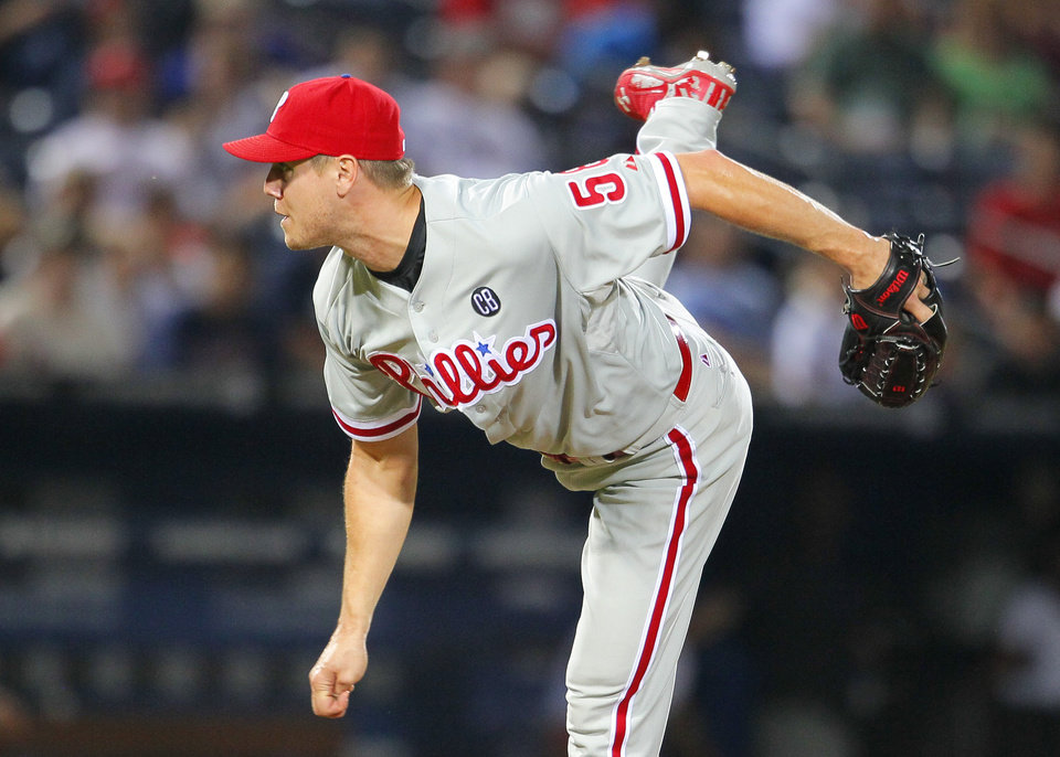 Photo - Philadelphia Phillies relief pitcher Jonathan Papelbon (58) delivers in the ninth inning of a baseball game against the Atlanta Braves Tuesday, June 17, 2014, in Atlanta. (AP Photo/Todd Kirkland)