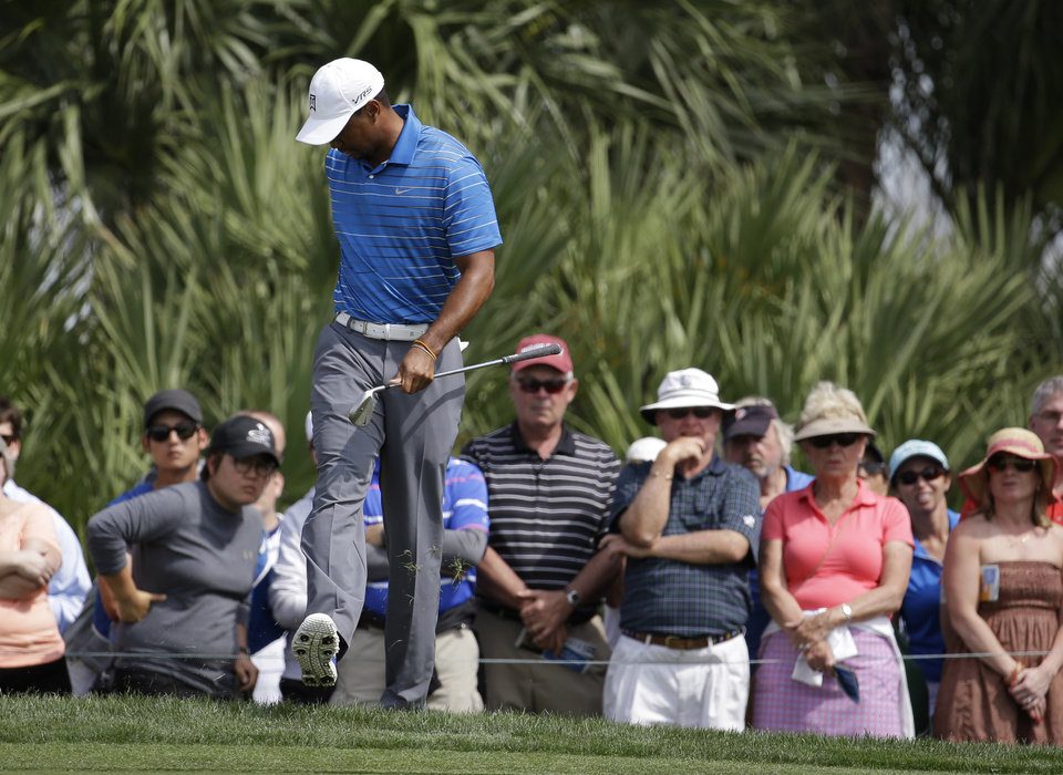 Photo - Tiger Woods kicks the ground after over hitting on the eighth green during the first round of the Honda Classic golf tournament, Thursday, Feb. 27, 2014, in Palm Beach Gardens, Fla. (AP Photo/Lynne Sladky)