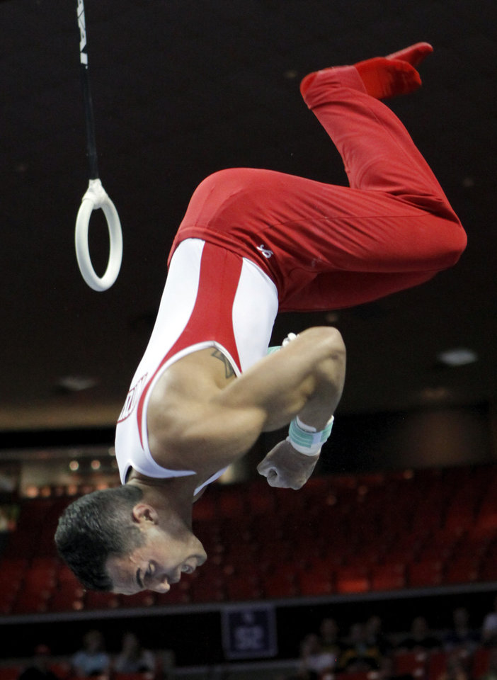 Photo - Oklahoma's Troy Nitzky dismounts from the rings at the event finals of the men's NCAA Men's Gymnastics Championships at the Lloyd Noble Center on Saturday, April 21, 2012, in Norman, Okla.  Photo by Steve Sisney, The Oklahoman