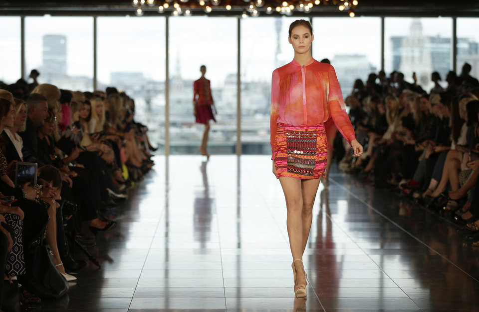 Photo -   EDS NOTE NUDITY A model wears a creation by Matthew Williamson for his Spring/Summer 2013 collection at London Fashion Week in London, Sunday, Sept. 16, 2012. (AP Photo/Alastair Grant)