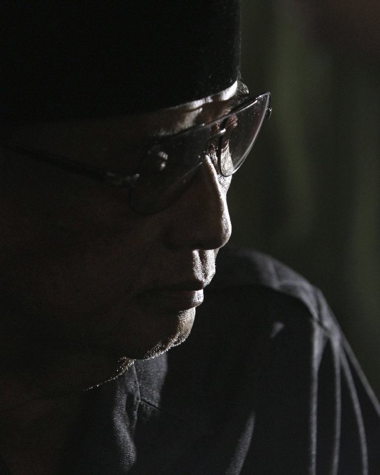 Filipino Sultan Jamalul Kiram III listens to questions from reporters at his residence in suburban Taguig, south of Manila, Philippines on Sunday March 3, 2013. Malaysia's police chief said at least seven people have been killed in a shootout between police and suspected Filipino members of the Muslim royal clan on Borneo island. (AP Photo/Aaron Favila)