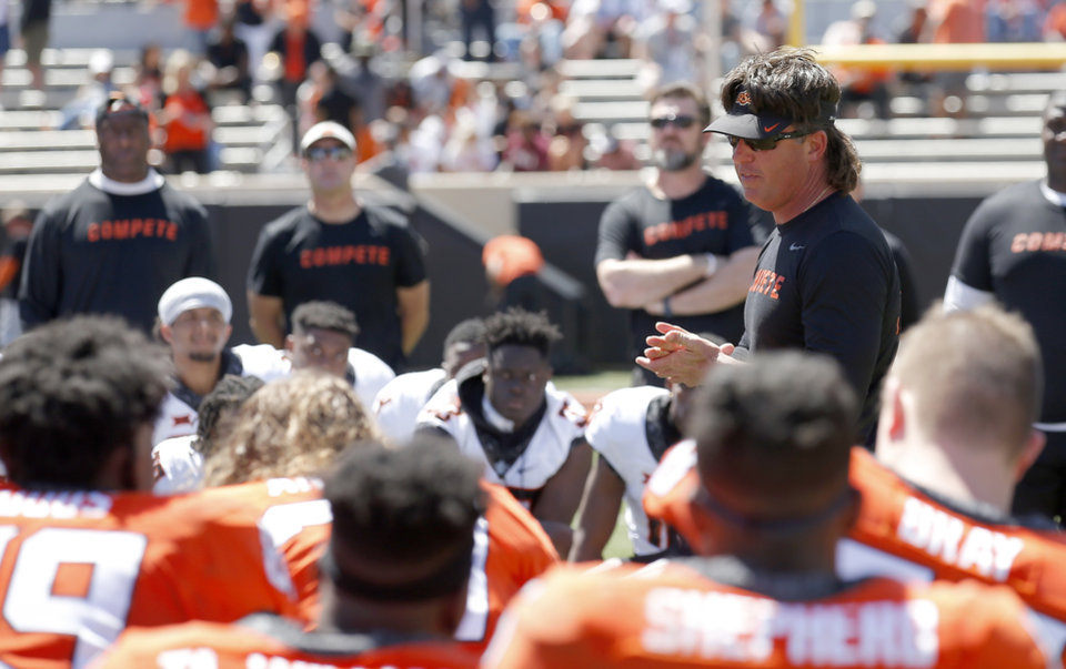 Photo - Oklahoma State head coach Mike Gundy talks the team following the Oklahoma State Cowboys spring practice at Boone Pickens Stadium in Stillwater, Okla., Saturday, April 20, 2019.  Photo by Sarah Phipps, The Oklahoman