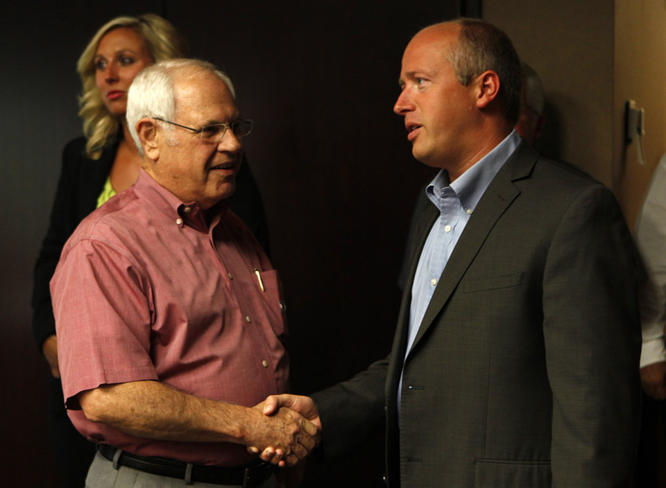 Photo - Brian Maughan (right) greets Stan Inman, former Oklahoma County Commissioner, during a watch party for Brian Maughan, incumbent candidate for county commissioner, Tuesday, June 26, 2012.  Photo by Garett Fisbeck, The Oklahoman