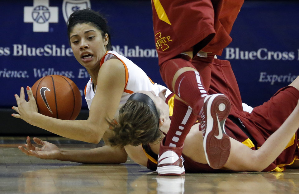OKLAHOMA STATE UNIVERSITY / OSU: Oklahoma State's Brittney Martin (22) fights for control of a loose ball with Iowa State's Hallie Christofferson (5) during the women's college basketball game between Oklahoma State and Iowa State at  Gallagher-Iba Arena in Stillwater, Okla.,  Sunday,Jan. 20, 2013.  OSU won 71-42. Photo by Sarah Phipps, The Oklahoman