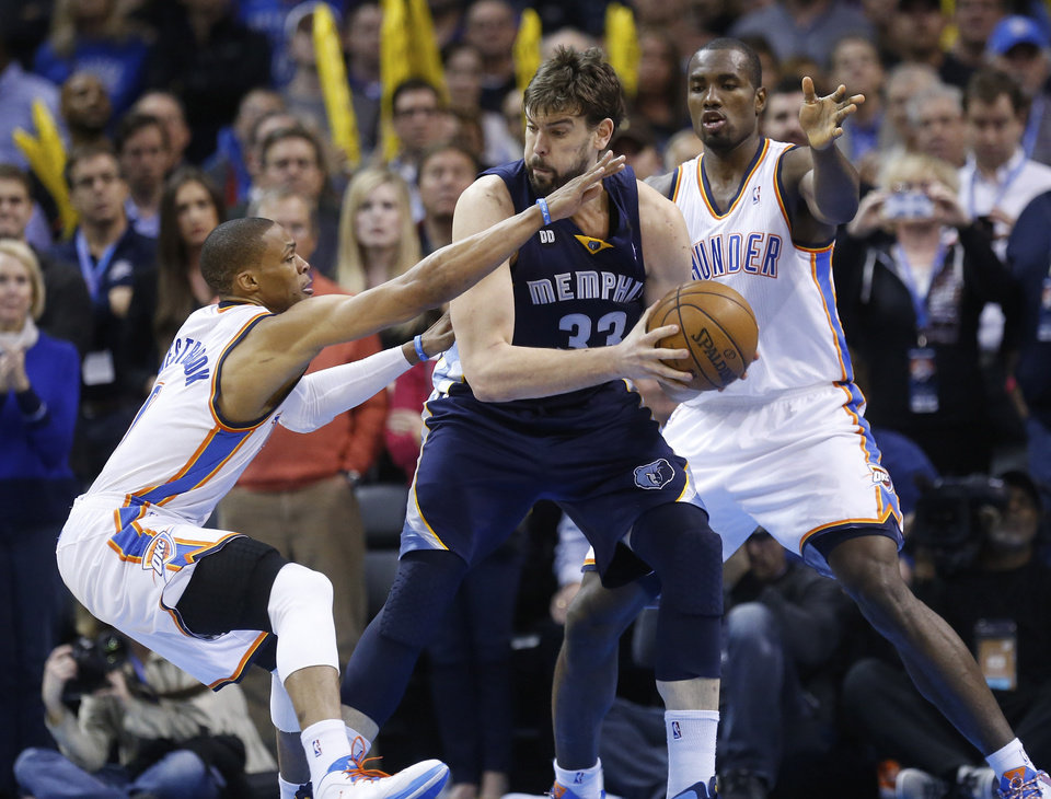 Memphis Grizzlies center Marc Gasol (33) keeps the ball from Oklahoma City Thunder guard Russell Westbrook (0) and forward Serge Ibaka (9) in the fourth quarter of an NBA basketball game in Oklahoma City, Thursday, Jan. 31, 2013. Oklahoma City won 106-89. (AP Photo/Sue Ogrocki)