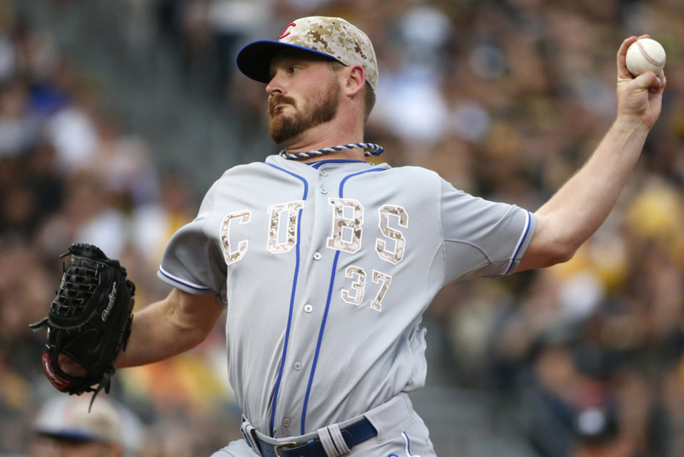 Photo - Chicago Cubs starting pitcher Travis Wood (37) delivers during the first inning of a baseball game against the Pittsburgh Pirates in Pittsburgh Tuesday, June 10, 2014. (AP Photo/Gene J. Puskar)