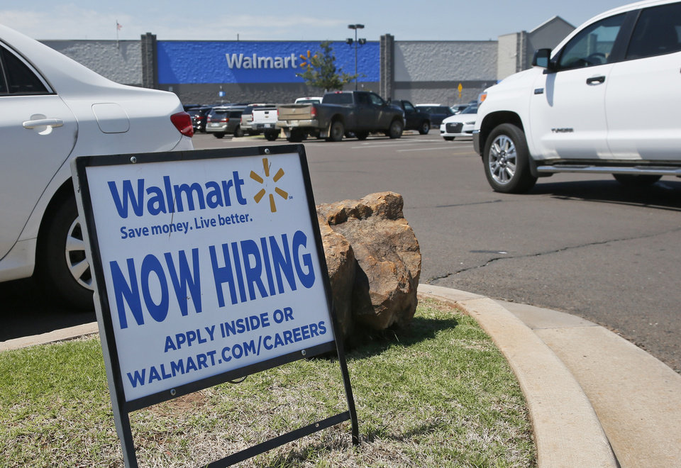 Photo - This Tuesday, May 30, 2017, photo shows a sign in the parking lot of a Walmart announcing that the store is hiring, in Oklahoma City. [AP Photo/Sue Ogrocki]