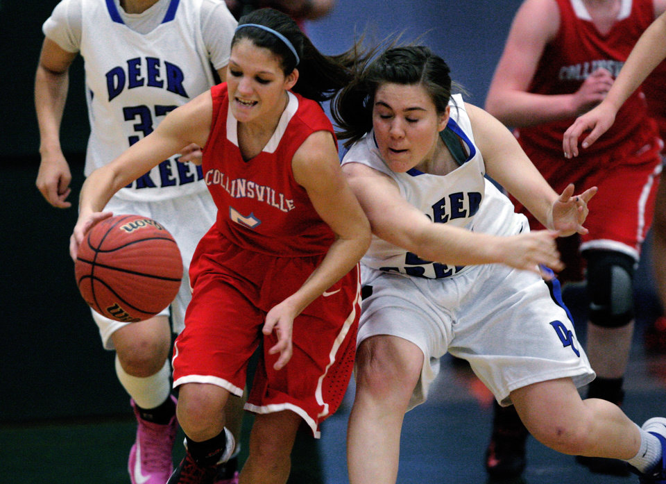 Photo - Collinsville's Shelbie Kirby (left) tries to keep the ball away from the defense of Deer Creek's Raven Crisp (32), during their first round 5A girls playoff matchup, in Catoosa, on Thursday, March 7, 2013. CORY YOUNG/Tulsa World