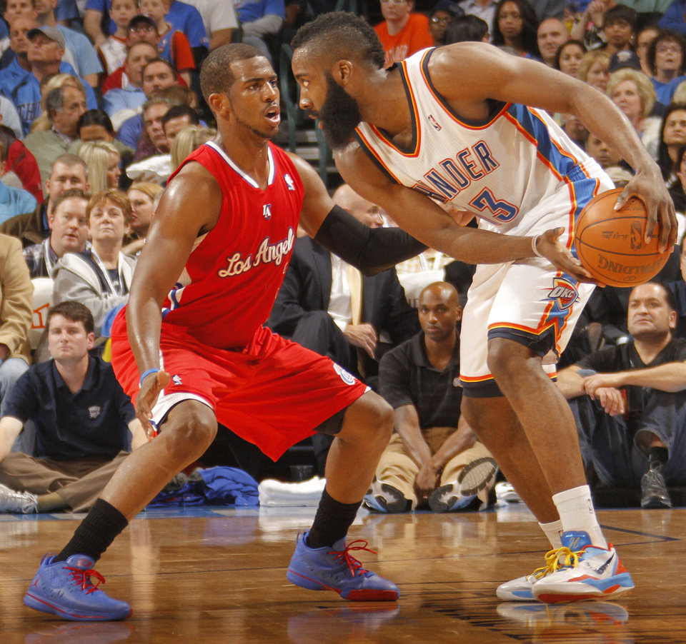 Los Angeles Clippers point guard Chris Paul (3) defends on Oklahoma City Thunder guard James Harden (13) during the NBA basketball game between the Oklahoma City Thunder and the Los Angeles Clippers at Chesapeake Energy Arena on Wednesday, March 21, 2012 in Oklahoma City, Okla.  Photo by Chris Landsberger, The Oklahoman