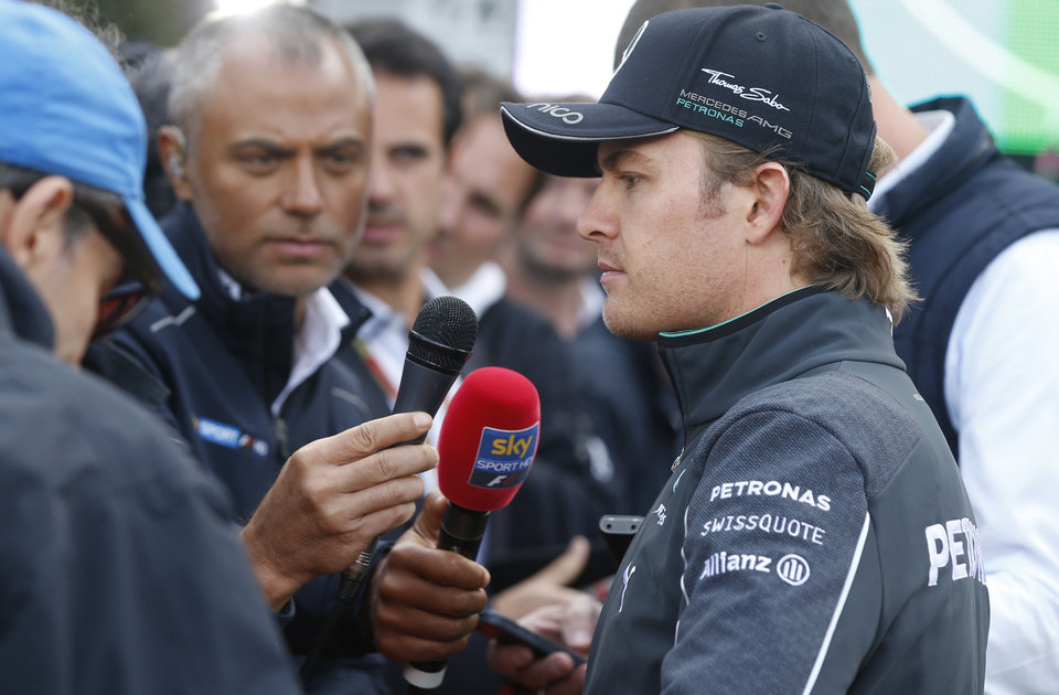 Photo - Mercedes driver Nico Rosberg of Germany answers reporters after the Belgium Formula One Grand Prix at the Spa-Francorchamps circuit, Belgium, Sunday, Aug. 24, 2014. The increasingly strained relations at Mercedes look set to get even worse after Rosberg effectively ended Hamilton's race chances with a risky overtaking move that saw him clip and puncture the Briton's left tire. (AP Photo/Luca Bruno)
