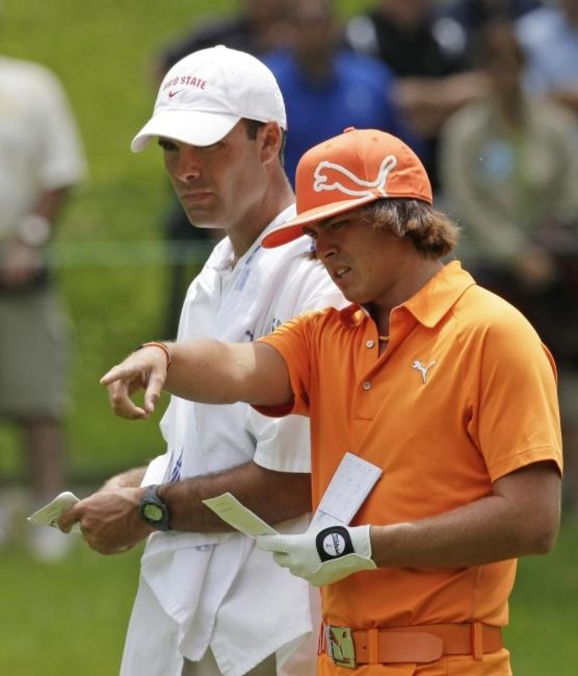Photo -  Oklahoma State assistant coach Donnie Darr, left, caddied for former Cowboy and current PGA star Rickie Fowler during the Memorial golf tournament in 2010 in Dublin, Ohio. [AP file photo/Tony Dejak]