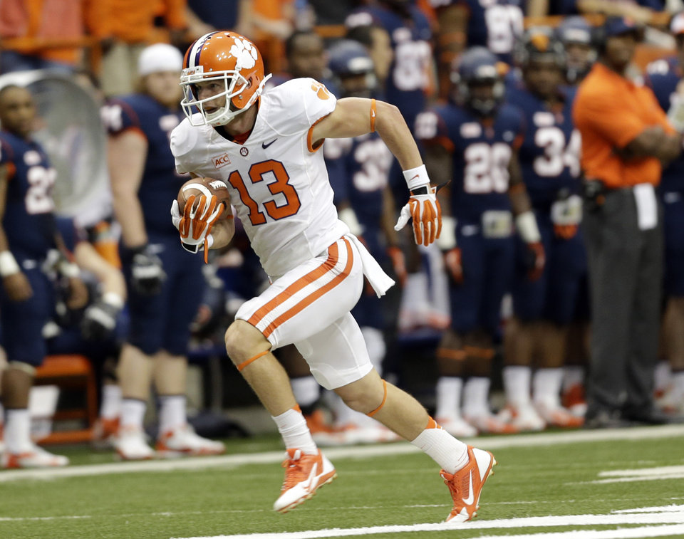 Photo - Clemson wide receiver Adam Humphries (13) runs for a touchdown after a catch during the first half of an NCAA college football game against Syracuse on Saturday, Oct. 5, 2013, in Syracuse, N.Y. (AP Photo/Mike Groll)