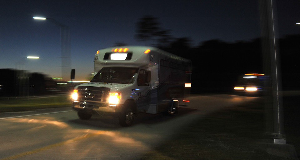 Photo - Shuttles used to move people out of Jacksonville International Airport drive by Tuesday, Oct. 1, 2013, in Jacksonville, Fla. The airport was evacuated after authorities found two suspicious packages. (AP Photo/The Florida Times-Union, Bruce Lipsky)