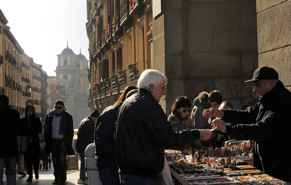 A man sells handmade crafts in Madrid, Sunday, Jan. 6, 2013. The number of people registered as unemployed in Spain has gone down, bringing some cheer as the country looks to emerge from recession in 2013. Figures released Thursday showed the registered jobless figure dropped by 59,094 in December compared to November, making for a rounded total of 4.8 million people listed as unemployed. (AP Photo/Andres Kudacki)