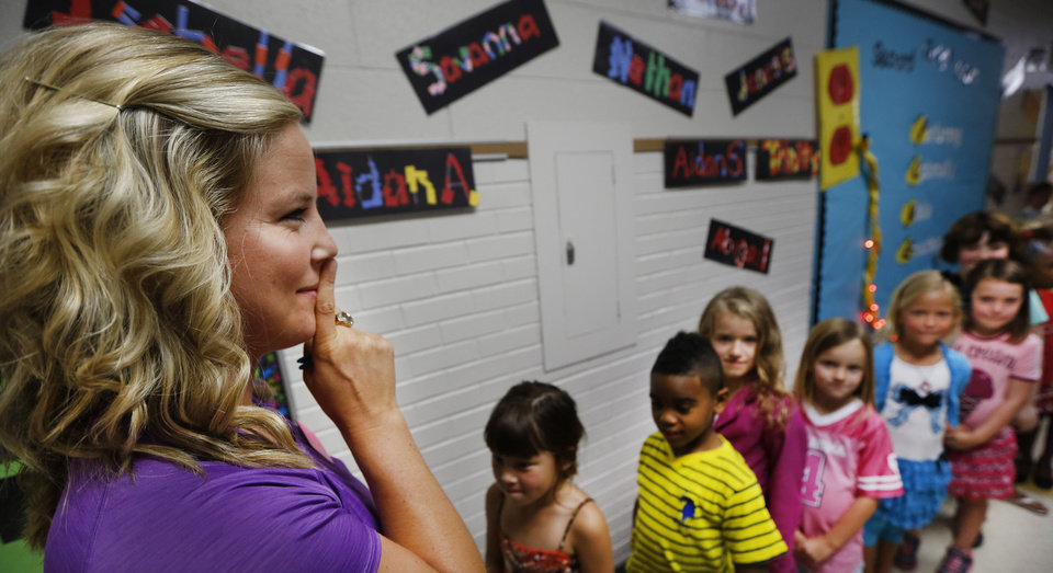 Orivis Risner Elementary School  teacher Laurin Fain signals her students to be quiet during her physical education class. Photo By Steve Gooch, The Oklahoman <strong>Steve Gooch - The Oklahoman</strong>