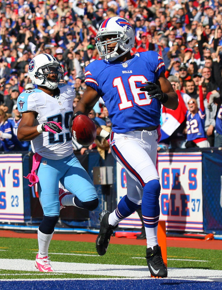 Photo -   Buffalo Bills' Brad Smith (16) scores a touchdown on a kickoff return in front of Tennessee Titans defender Ryan Mouton (29) during the first half of an NFL football game in Orchard Park, N.Y., Sunday, Oct. 21, 2012. (AP Photo/Bill Wippert)
