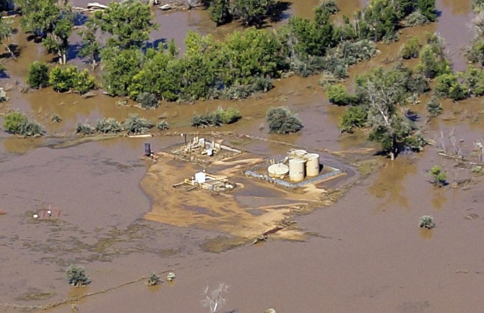Photo - This Sept. 17, 2013 photo provided by Ecoflight shows the result of flash floods that swamped well pads and in some cases dislodged storage tanks in Weld County, Colo. Hundreds of natural gas and oil wells along with pipelines are shut down by flooding, as state and federal inspectors are gauging the damage and looking for contamination from inundated oil fields. (AP Photo/Ecoflight, Jane Pargiter)