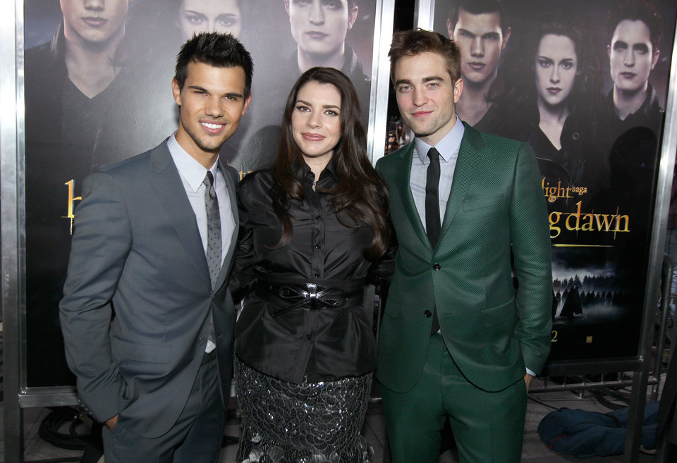 "From left, Taylor Lautner, Stephenie Meyer, and Robert Pattinson attend the world premiere of ""The Twilight Saga: Breaking Dawn Part II"" at the Nokia Theatre on Monday, Nov. 12, 2012, in Los Angeles. (Photo by Matt Sayles/Invision/AP) ORG XMIT: CAENT596"