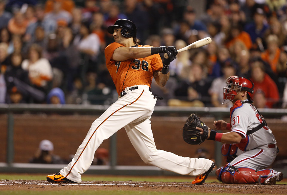 Photo - San Francisco Giants' Michael Morse follows through on a three-run home run during the fourth inning of a baseball game against the Philadelphia Phillies, Friday, Aug. 15, 2014, in San Francisco. (AP Photo/Beck Diefenbach)
