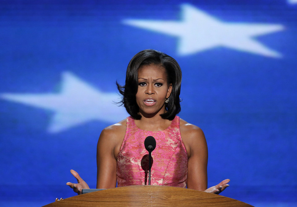 Photo - First Lady Michelle Obama addresses the Democratic National Convention in Charlotte, N.C., on Tuesday, Sept. 4, 2012. (AP Photo/J. Scott Applewhite)  ORG XMIT: DNC189