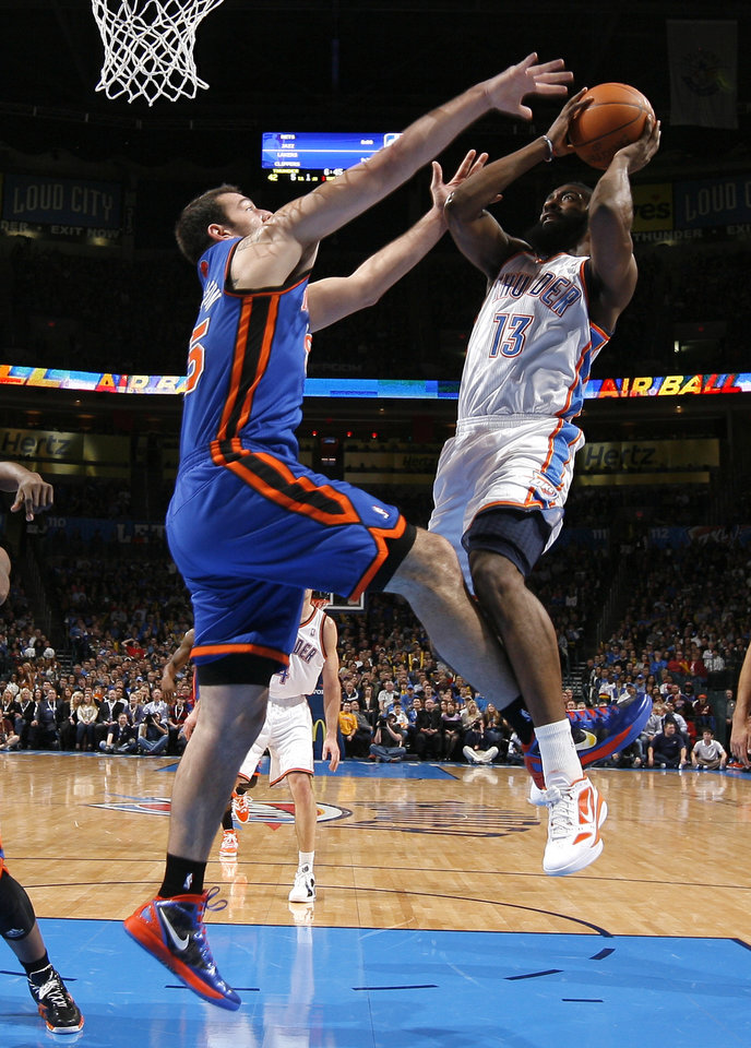 Oklahoma City\'s James Harden (13) shoots the ball beside New York\'s Josh Harrellson (55) during the NBA game between the Oklahoma City Thunder and the New York Knicks at Chesapeake Energy Arena in Oklahoma CIty, Saturday, Jan. 14, 2012. Photo by Bryan Terry, The Oklahoman