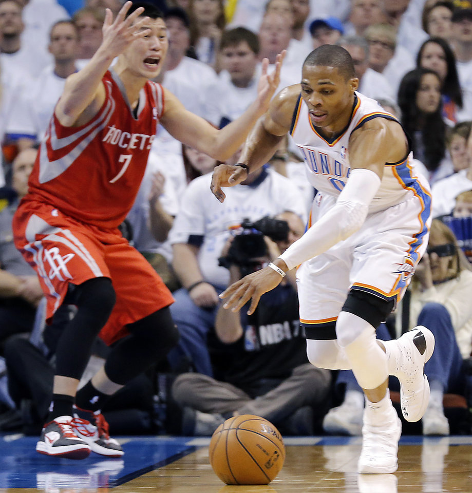 Photo - Oklahoma City's Russell Westbrook (0) gets a steal on Houston's Jeremy Lin (7) during Game 2 in the first round of the NBA playoffs between the Oklahoma City Thunder and the Houston Rockets at Chesapeake Energy Arena in Oklahoma City, Wednesday, April 24, 2013. Photo by Chris Landsberger, The Oklahoman