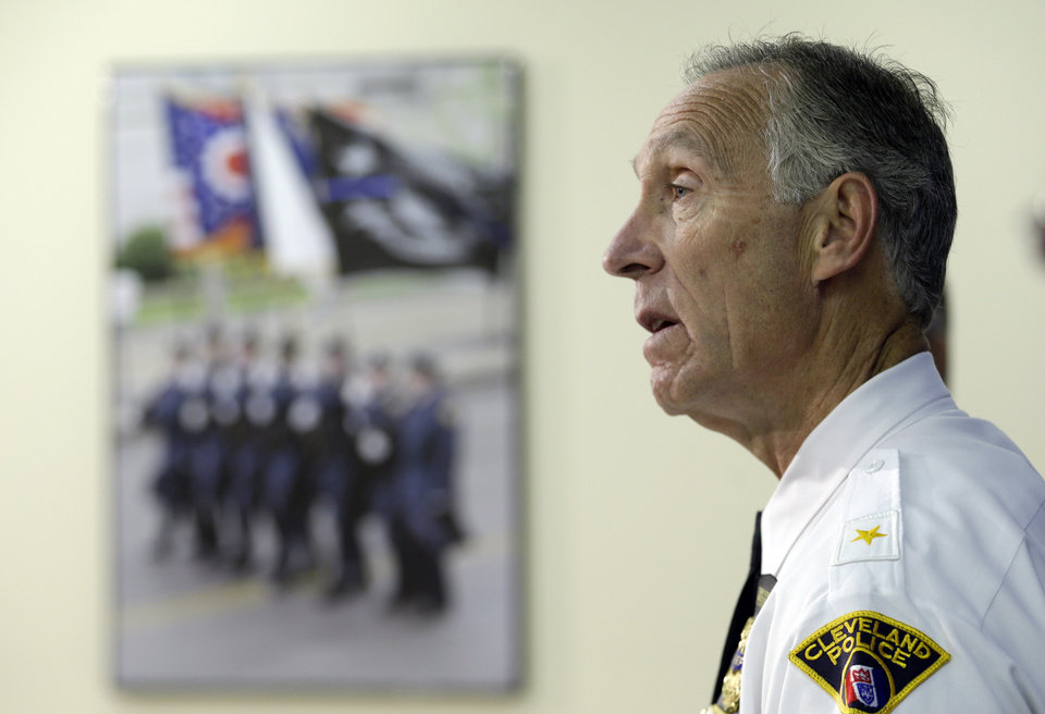 Photo - Cleveland Police Chief Michael McGrath announces the results of disciplinary hearings for officers involved in a deadly chase Tuesday, Oct. 15, 2013, in Cleveland. McGrath said 63 officers have been suspended for breaking departmental rules in connection with a police chase in November 2012. (AP Photo/Tony Dejak)