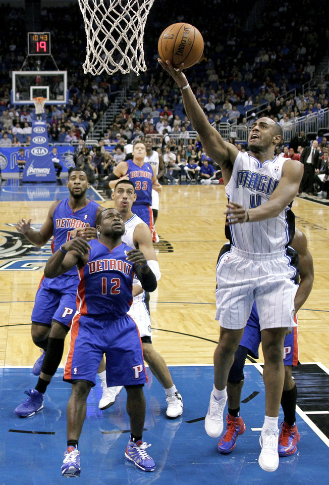 Orlando Magic\'s Arron Afflalo, right, gets in a shot in front of Detroit Pistons\' Will Bynum (12) during the first half of an NBA basketball game, Wednesday, Nov. 21, 2012, in Orlando, Fla. (AP Photo/John Raoux)