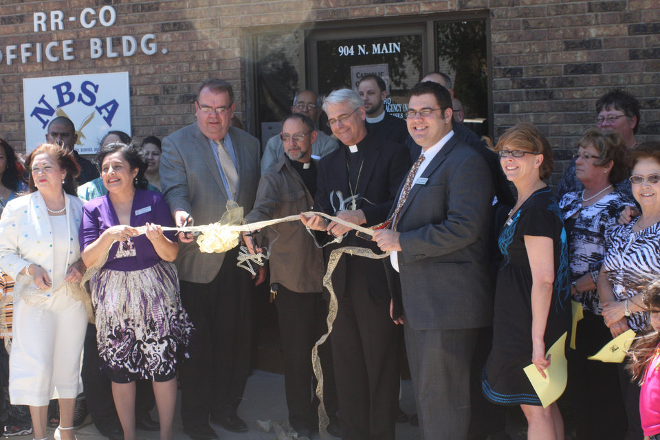 Photo - Catholic Charities leaders participate in the dedication of the new Catholic Charities regional office in Guymon in May 2012. Photo provided
