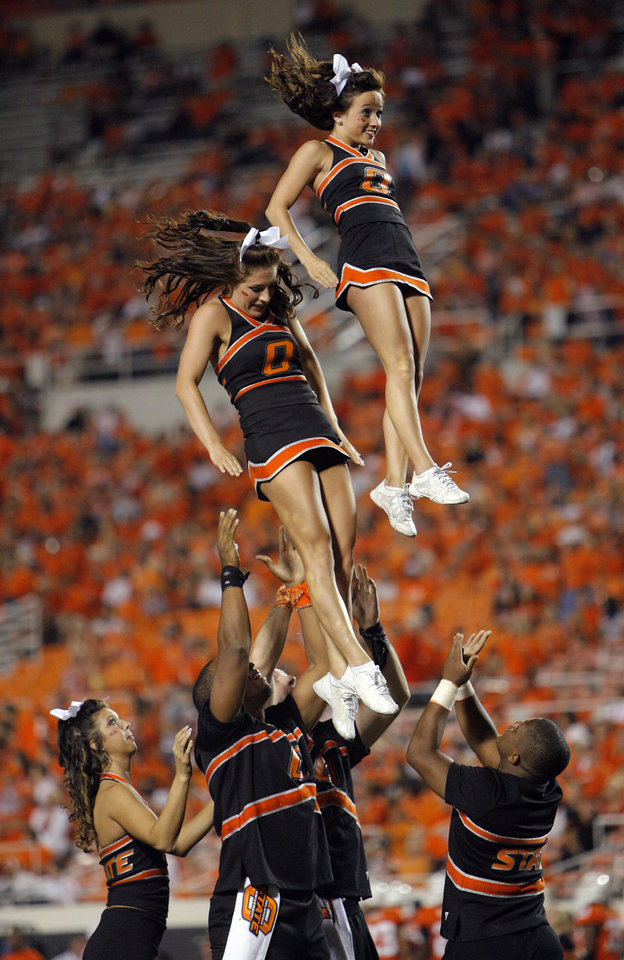 Photo - OSU cheerleaders during the college football game between the Washington State Cougars (WSU) and the Oklahoma State Cowboys (OSU) at Boone Pickens Stadium in Stillwater, Okla., Saturday, September 4, 2010. OSU won, 65-17. Photo by Nate Billings, The Oklahoman