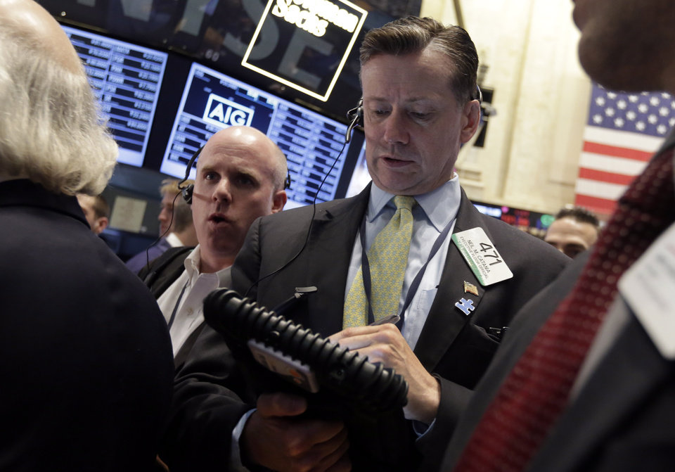 Photo - Trader Neil Catania, right, works on the floor of the New York Stock Exchange, Friday, May 23, 2014. Stocks inched higher early Friday in quiet trading ahead of the Memorial Day weekend.  (AP Photo/Richard Drew)