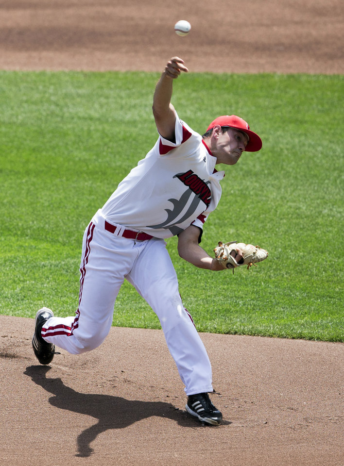 Photo - Louisville starting pitcher Anthony Kidston delivers against Texas in the first inning of an NCAA baseball College World Series elimination game, Monday, June 16, 2014, in Omaha, Neb. (AP Photo/Nati Harnik)