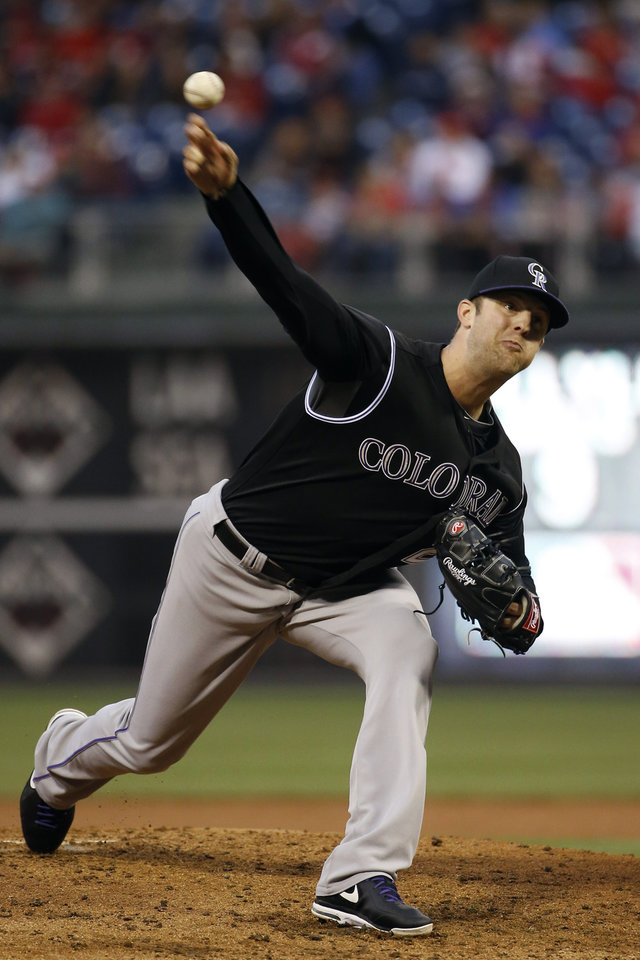 Photo - Colorado Rockies' Jordan Lyles pitches during the second inning of a baseball game against the Philadelphia Phillies, Wednesday, May 28, 2014, in Philadelphia. (AP Photo/Matt Slocum)