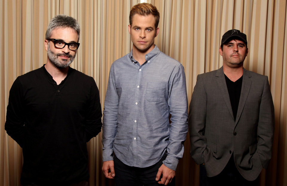 "Photo - From left, writer-director Alex Kurtzman, actor Chris Pine  and writer-producer Roberto Orci from the film ""People Like Us.""   Photo by Matt Sayles/Invision/AP"