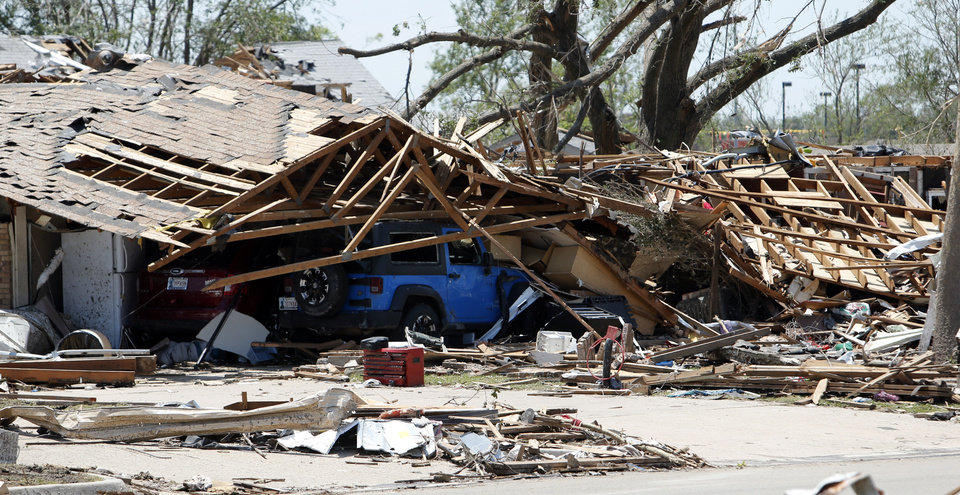 Photo - Monday's tornado damage east of Interstate 35  is evident on Wednesday, May 22, 2013 in Moore, Okla. Photo by Steve Sisney, The Oklahoman