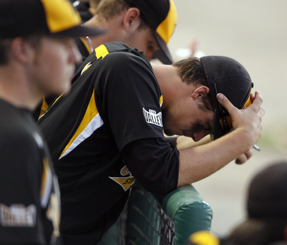 Photo - A Shocker is shocked as the Sooners come from behind as University of Oklahoma plays Wichita State at L. Dale Mitchell Park in the NCAA Regional baseball tournament in Norman, Okla. on Friday, May 29, 2009. 