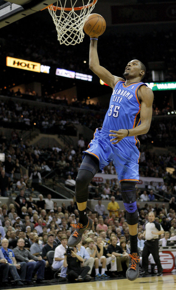 Photo - Oklahoma City's Kevin Durant (35) goes to the basket during Game 2 of the Western Conference Finals between the Oklahoma City Thunder and the San Antonio Spurs in the NBA playoffs at the AT&T Center in San Antonio, Texas, Tuesday, May 29, 2012. Oklahoma City lost 120-111. Photo by Bryan Terry, The Oklahoman