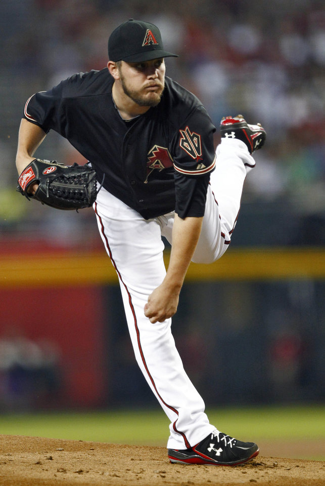 Photo -   Arizona Diamondbacks pitcher Wade Miley delivers a pitch against the Washington Nationals during the first inning of a baseball game, Saturday, Aug. 11, 2012, in Phoenix. (AP Photo/Matt York)