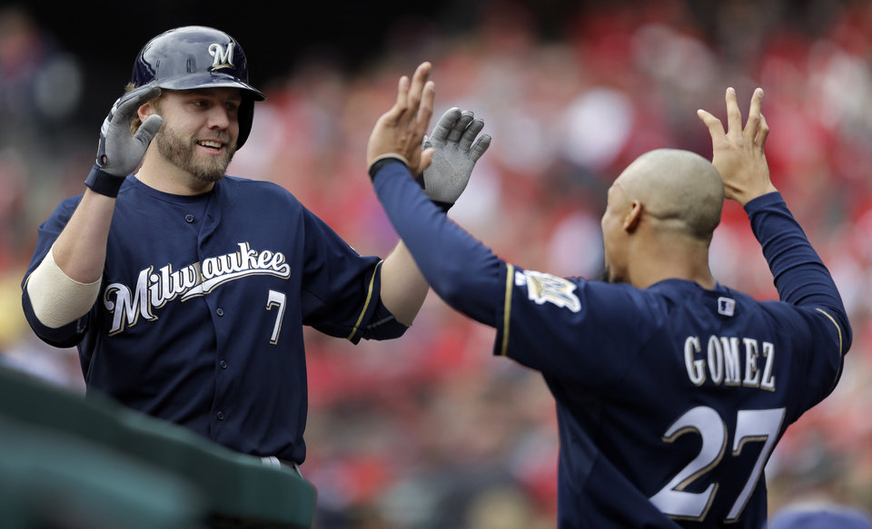 Photo - Milwaukee Brewers' Mark Reynolds, left, is congratulated by teammate Carlos Gomez after hitting a two-run home run during the second inning of a baseball game against the St. Louis Cardinals Wednesday, April 30, 2014, in St. Louis. (AP Photo/Jeff Roberson)