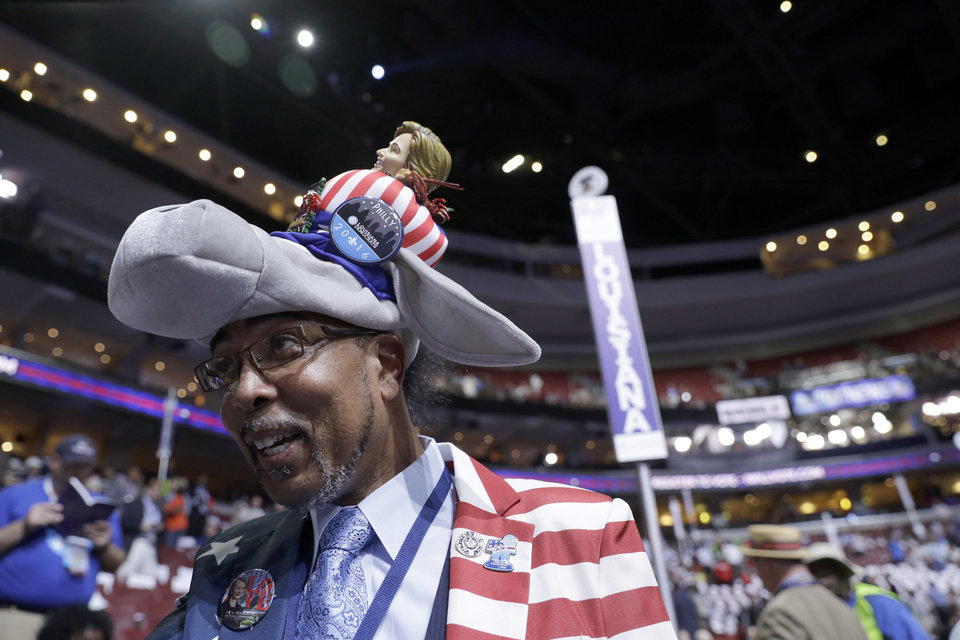 Photo - Delegate Rodney McFarland from Monroe, La., arrives at the Wells Fargo Arena before the start of the first day session of the Democratic National Convention in Philadelphia, Monday, July 25, 2016. (AP Photo/John Locher)