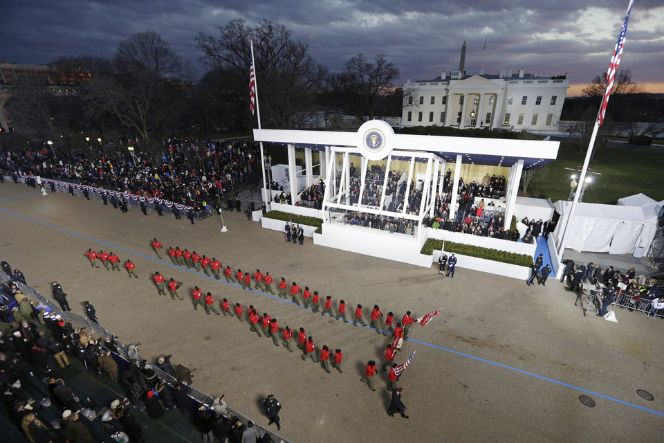 Boy Scout Troop 358, Germantown, Pennsylvania peform while passing the presidential box and the White House during the Inaugural parade, Monday, Jan. 21, 2013, in Washington. Thousands  marched during the 57th Presidential Inauguration parade after the ceremonial swearing-in of President Barack Obama. (AP Photo/Charlie Neibergall ) ORG XMIT: DCMS165