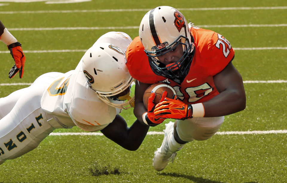 Photo - Oklahoma State's Barry J. Sanders (26) gets to the one foot line on a play in the first quarter during the college football game between the Oklahoma State Cowboys (OSU) and the Southeastern Louisiana Lions at Boone Pickens Stadium in Stillwater, Okla., Saturday, Sept. 12, 2015. Photo by Steve Sisney, The Oklahoman