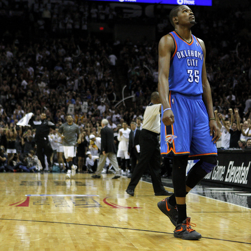 Photo - Oklahoma City's Kevin Durant (35) walks towards the bench as San Antonio celebrates during Game 2 of the Western Conference Finals between the Oklahoma City Thunder and the San Antonio Spurs in the NBA playoffs at the AT&T Center in San Antonio, Texas, Tuesday, May 29, 2012. Oklahoma City lost 120-111. Photo by Bryan Terry, The Oklahoman