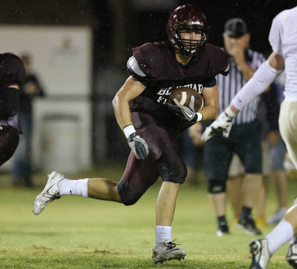 Photo - Blanchard's Brandon Montano runs during a high school football scrimmage between Blanchard and Kingfisher in Blanchard, Okla., Thursday, August 28, 2014. Photo by Bryan Terry, The Oklahoman